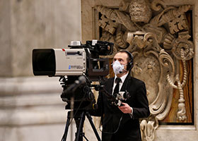 videographer at Vatican in mask